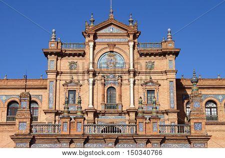 Facade of a baroque palace in Plaza de Espana (square of Spain) in Sevilla, Spain