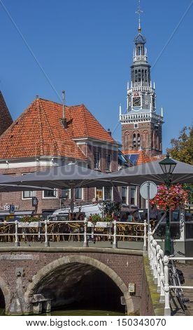 ALKMAAR, NETHERLANDS - SEPTEMBER 13, 2016: People sitting and drinking in front of the weigh house in Alkmaar