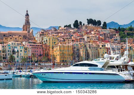 colorful houses and boats of Menton old town embankment, France