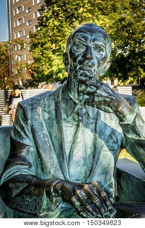 WARSAW POLAND - SEPTEMBER 27: Jan Karski Statue near the Museum of the History of Polish Jews in Warsaw Poland on September 27 2016