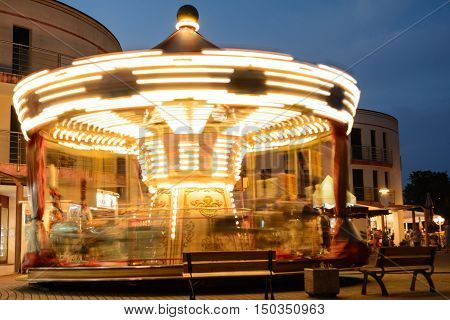 Light in motion with him rotating carousel at night