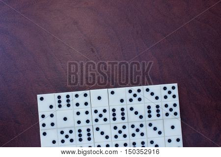 Domino - a game during which builds a chain knuckles in contact halves with the same number of points