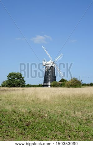 BURNHAM OVERY STAITHE, UK - AUGUST 30, 2016: The tower Windmill, built in 1816 was used as a corn ill until damaged by a storm, Norfolk, UK