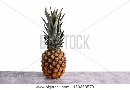 Perfect Pineapple Is On The Table And On A White Background In The Studio. Vitamins. Green Pineapple