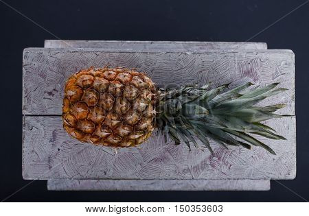 Perfect Pineapple Lying On A Wooden Table On A Dark Background In The Studio. Vitamins. Green Pineap