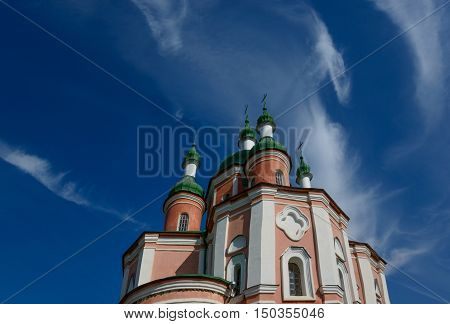 Sts. Peter and Paul Church of Trinity Monastery against blue sky background. Place - Gustin village Ukraine.