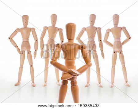 Wooden dummy characters. Head and his team team leader hierarchy or leadership concept