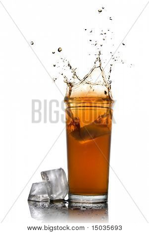 Beautiful splash of cola in glass and ice cubes isolated on white