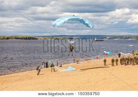 SAMARA RUSSIA - SEPTEMBER 11 2016: Military parachutists jumper on a wing parachute execute a controlled descent by parachute on a beach