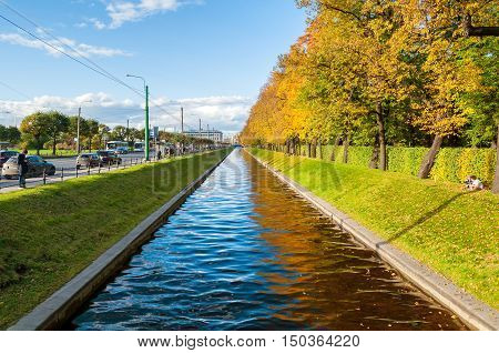 ST PETERSBURG RUSSIA-OCTOBER 3 2016. Autumn landscape of St Petersburg - Swan Canal and autumn park in sunny weather. St Petersburg autumn city landscape