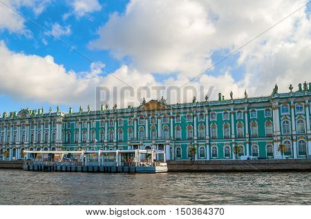 ST PETERSBURG RUSSIA-OCTOBER 3 2016. Winter Palace on the embankment of Neva river in St PetersburgRussia. Architecture landmark of St Petersburg in autumn sunny day