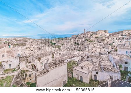 Typical House Of Stones (sassi Di Matera)  And Church Of Matera Under Blue Sky. Matera In Italy