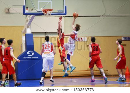 MOSCOW, RUSSIA - DECEMBER 12, 2015: Game moment under the ring during basketball match at the indoor stadium betwen CSKA and Labor Reserves teams.