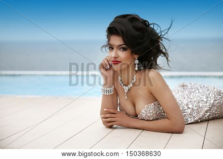 Elegant Beauty Fashion Brunette In Luxury Dress With Diamond Jewelry, Makeup Red Lips, Hairstyle. Gi