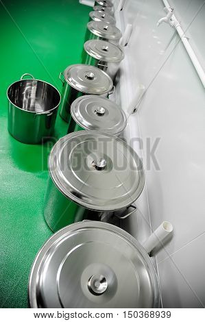 Row of industrial pans for mixology and preparations