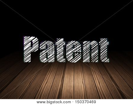 Law concept: Glowing text Patent in grunge dark room with Wooden Floor, black background