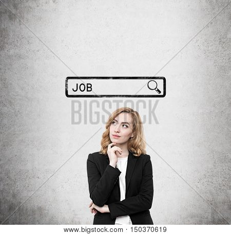 Woman with red hair standing near concrete wall with search bar sketch and word job. Concept of job finding. Mock up