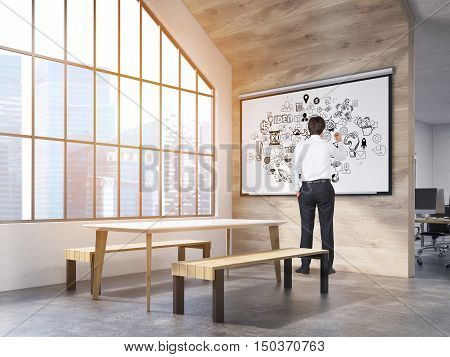 Man in office interior with whiteboard with business sketches table and benches and attic window. New York City. Concept of office recreation area. 3d rendering.