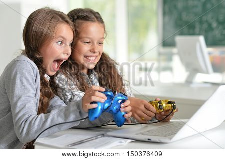 Portrait of a happy children with laptop at home