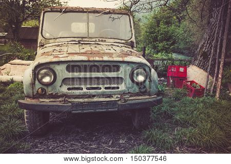 Closeup of old rust eaten russian jeep