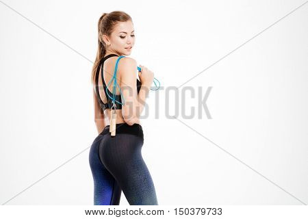 Attractive fitness girl holding skipping rope isolated on white background