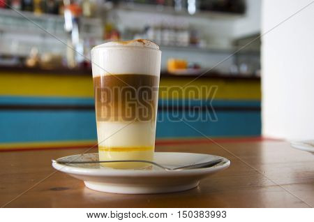 Barraquito - Traditional coffee in Tenerife ( Canary Islands) consisting of hot coffee milk milk condensed and liquor with lemon and cinnamon