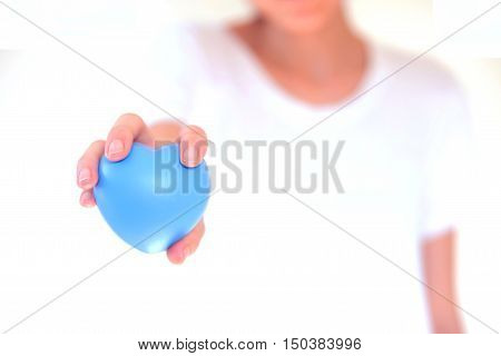 people relationship and love concept - close up of womans cupped hands showing red heart