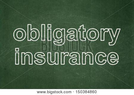Insurance concept: text Obligatory Insurance on Green chalkboard background