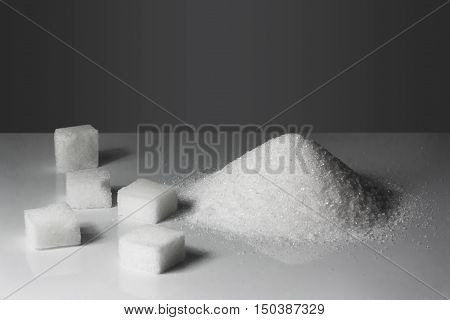 Lump Sugar On The Gray Background