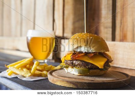 Tasty Hamburger With Fries And Glass Of Beer On Counter.