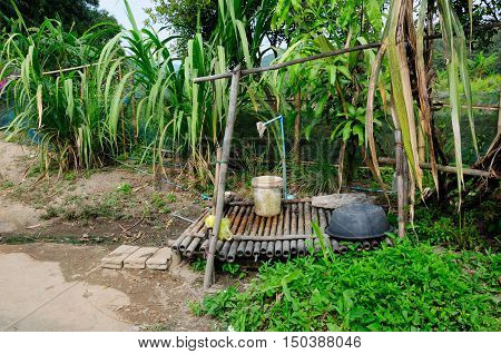 An outside washing station at a small village in Northern Thailand near chiang Rai.