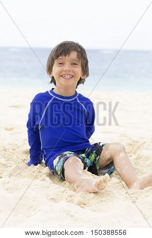Happy Boy Playing At The Beach