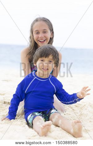 Happy Girl And Boy Playing At The Beach