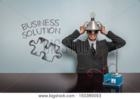 Business Solution text with vintage businessman and machine at office