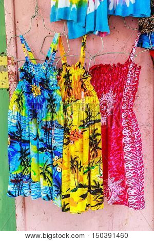 Tropical dresses in a Caribbean market.