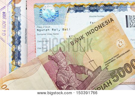 The visa of Indonesia in the passport and the Indonesian rupees