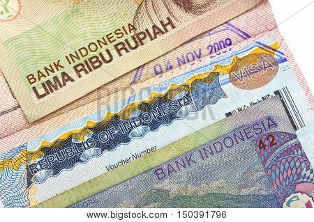 The visa of Indonesia in the passport and the Indonesian rupees closeup