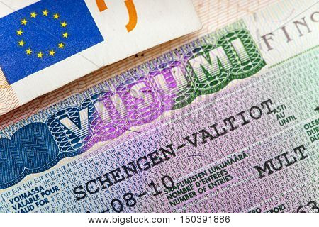 Schengen visa of Finland on the page of the passport close up