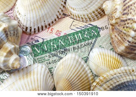 visa of Bulgaria on the page of the passport and sea shells