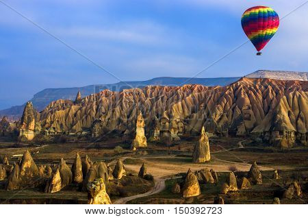 Colorful hot air balloon flying over the bewitching Cappadocia