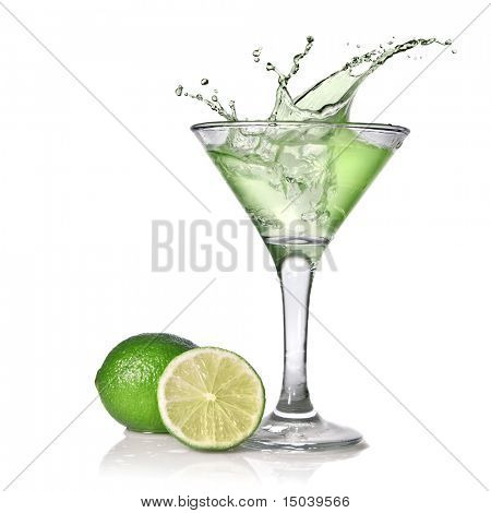 Green alcohol cocktail with splash and green lime isolated on white