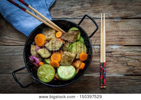 roasted vegetables on pot with chinese chopstick