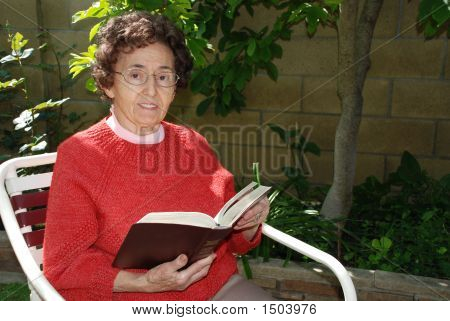 Grandmother With Bible In Garden