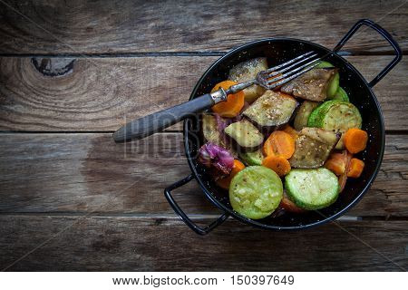 roasted vegetables on pot with old fork
