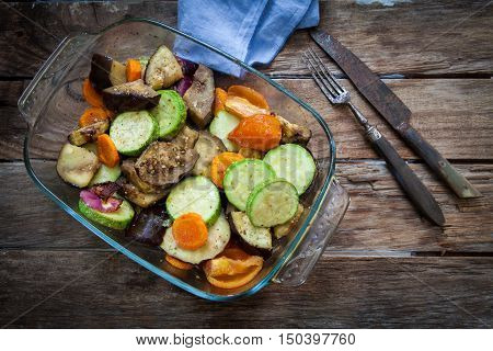 roasted vegetables on glass bowl on wood table
