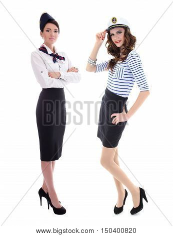 young women stewardesses posing in uniform isolated on white background