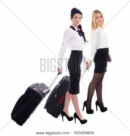 side view of two stewardesses with suitcases isolated on white background