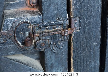iron lock - heck close up on old wooden closed door