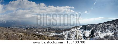 large panoramic view of snow covered mountains and valley in Utah. Usa