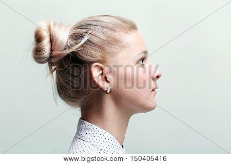 Blonde woman profile face. Girl profile face